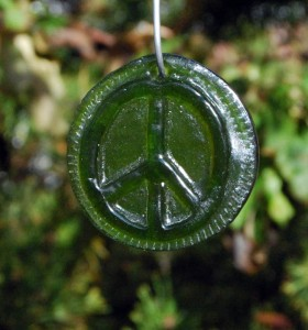 Recycled green bottle glass peace sign.