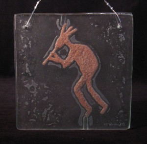 Petroglyph Kokopelli in Recycled Glass With Red Sand