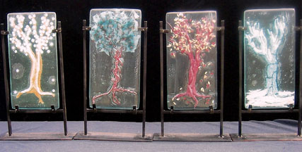 Metal, sand and other inclusions in recycled glass tree sculptures